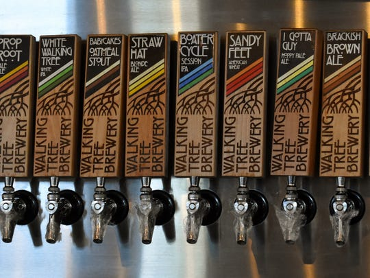 An array of beers on tap offers a wide selection to