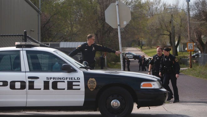 Springfield police investigating a scene near College Street and Lexington Avenue in March.