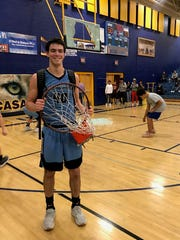 Shaun Wahlstrom poses with the rim and the shattered backboard at Goodyear Estrella Foothills on Jan. 25, 2018.