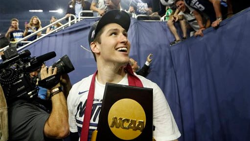 Villanova's Ryan Arcidiacono, whose cousin Nick plays for Rutgers football, celebrates after winning the national title.