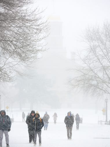 University of Iowa students stroll through the T. Anne