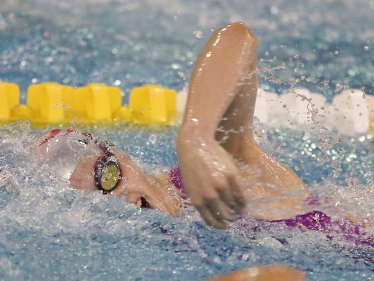 Newark Charter freshman Kate Menzer swims the opening leg of the 400 freestyle at the DIAA Swimming and Diving Championships. Menzer's older sister, Emma, anchoring the winning relay as the Patriots also won the team title.