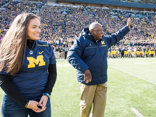 Emily Haydel and her grandfather, baseball Hall of Famer Hank Aaron, on the field at Michigan Stadium in Ann Arbor on Oct. 22, 2016. Emily graduated from the University of Michigan on April 29, 2017.