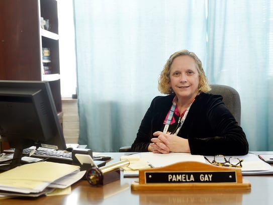 York County Coroner Pam Gay sits for a portrait at