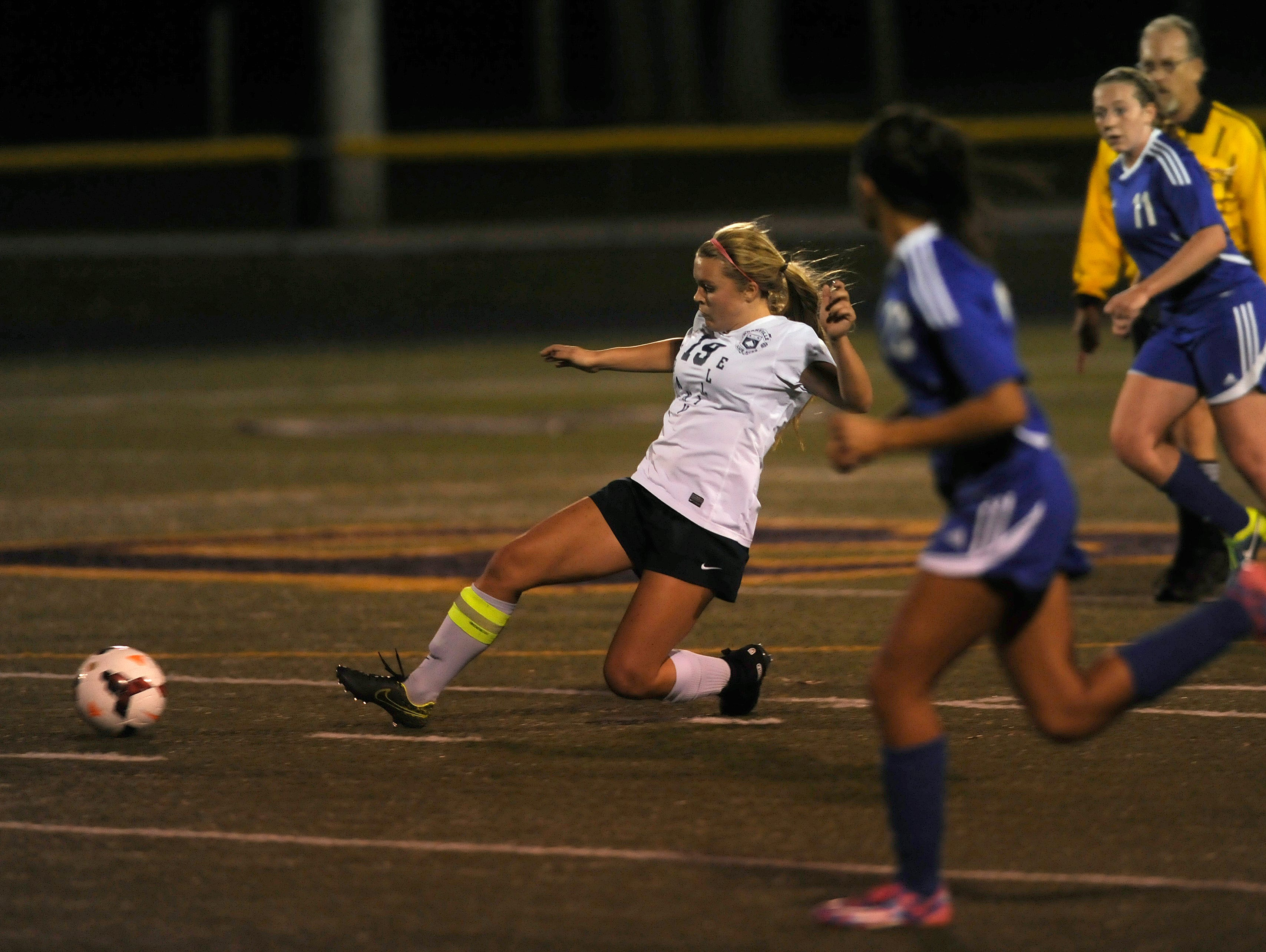 Granville's Nikki Cox passes to Rose Sawyers for an assist during Tuesday night's Division II regional semifinal game at Bloom-Carroll. The Blue Aces defeated Chillicothe 8-0.