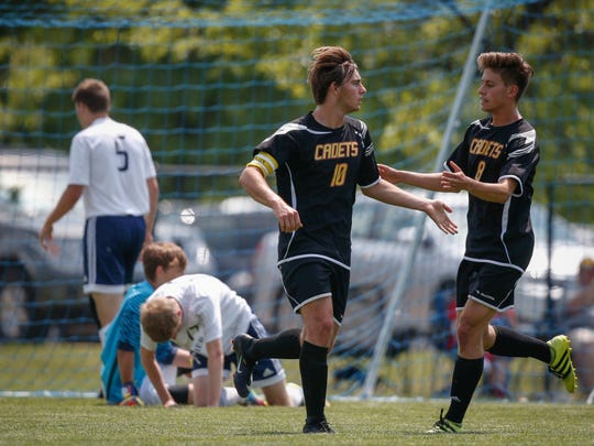Iowa Falls-Alden senior Marcos Vila, left, celebrates with teammate Pablo Frade, right, after Vila scored a goal against Cedar Rapids Xavier during the 2017 Iowa high school boys state soccer tournament at Cownie Soccer Park in Des Moines on Friday, June 2, 2017.