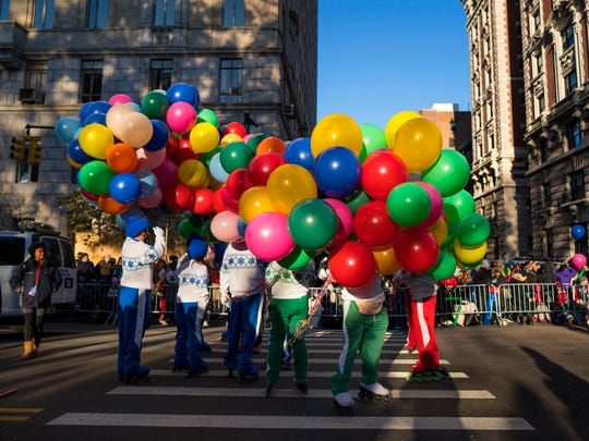 Participants take their places along the parade route before the Macy's Thanksgiving Day Parade begins on Thursday.