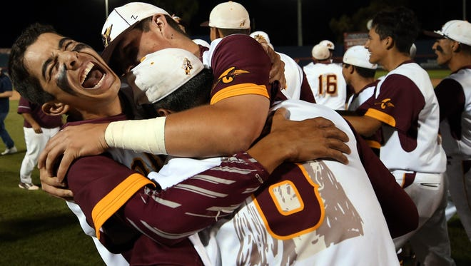Nogales' Ricky Maytorena (3) gets mobbed by a few teammate after their win over Salpointe in the state 4A championship game at Hi Corbett, Saturday, May 13, 2017, Tucson, Ariz.