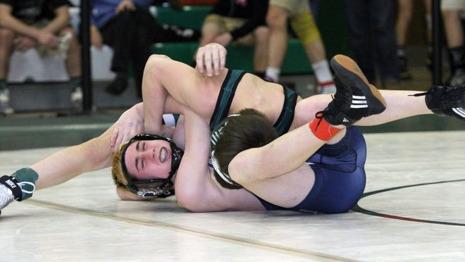 NJSIAA District 12 wrestling tournament held at South Plainfield High School in South Plainfield on Friday February 20, 2015. South Plainfield High School's Joe Heilmann (top) battles Matthew Sternesky of Colonia High School during the 106 lb. bout.