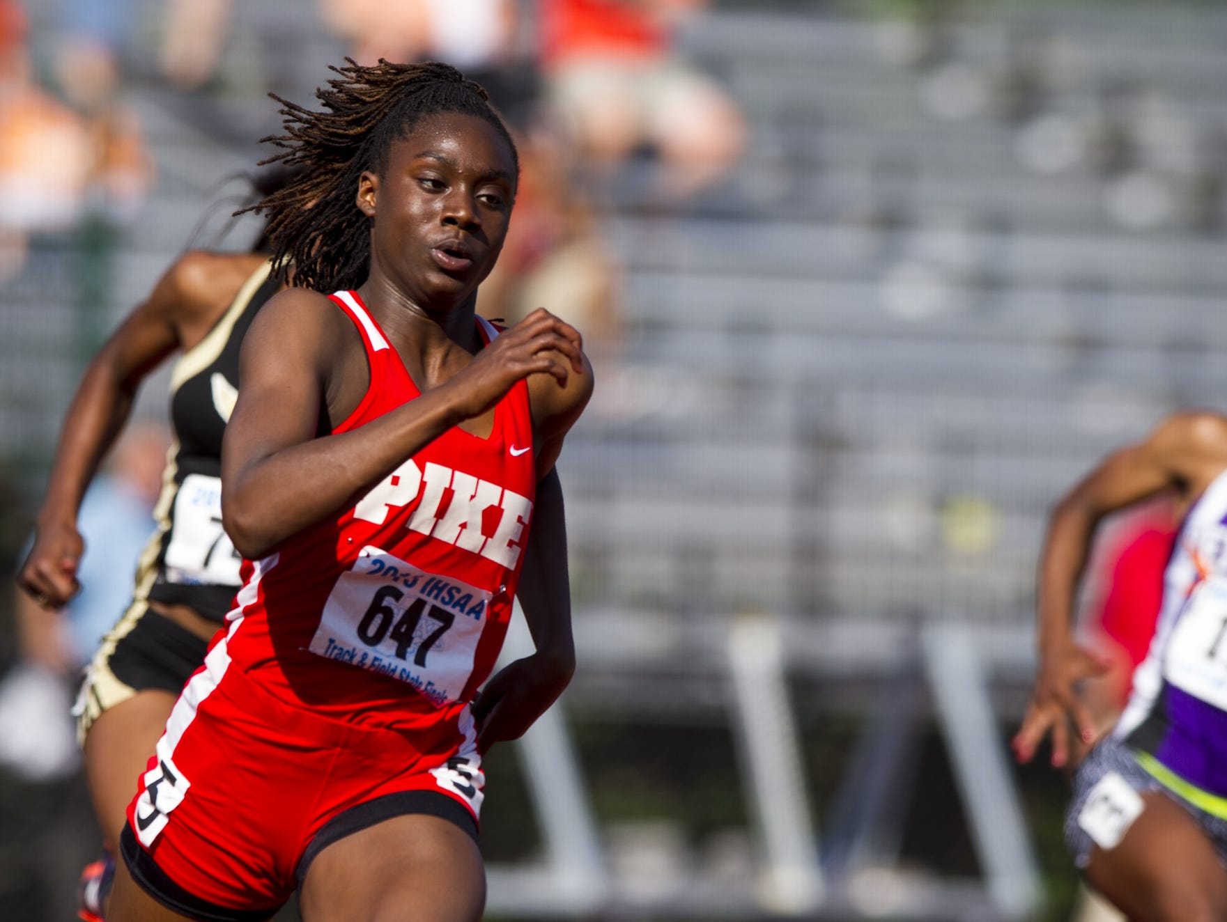 Pike High School sophomore Lynna Irby (647) competes in the 200 Meter Dash. The 42nd Annual Girl's Track and Field State Finals were held Saturday, June 6, 2015, at the Robert C. Haugh Track and Field Complex on the campus of Indiana University in Bloomington, Ind.