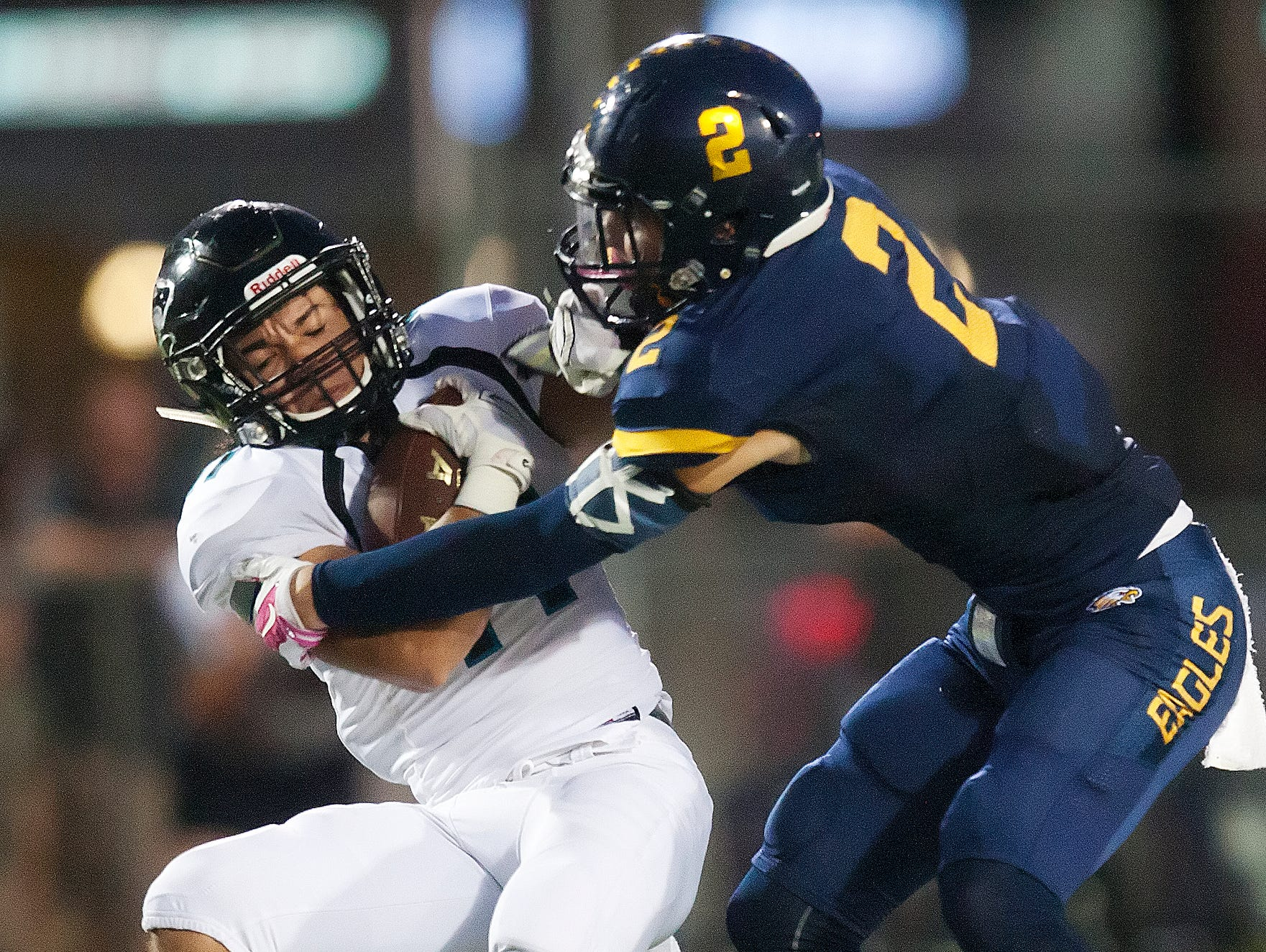 Naples High School's Chris Riley, right, tackles Gulf Coast's Daniel Rendon for a loss Friday at Naples High School. Naples beat Gulf Coast 42-6.