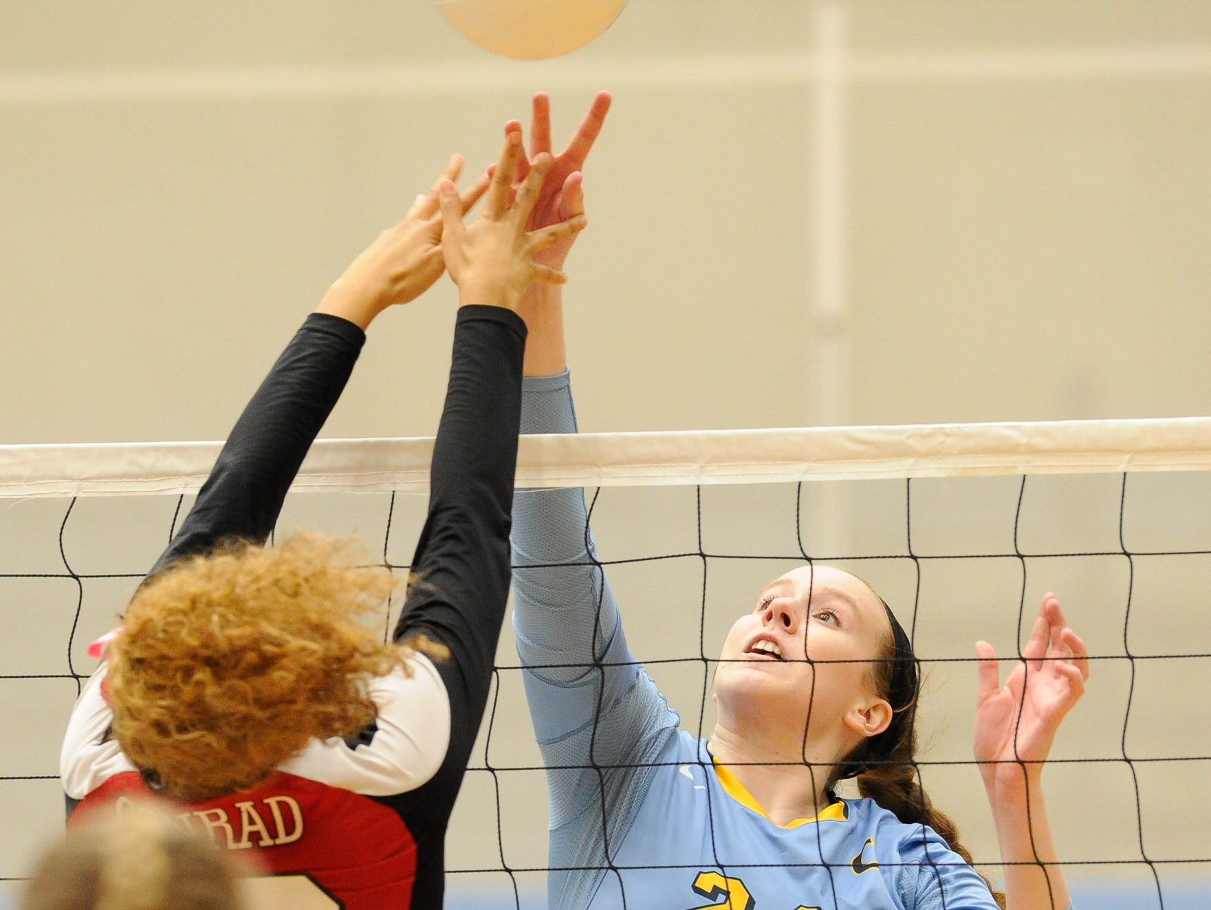 Cape's #24 Abigail E'Nama with a spike in the second game against Conrad Thursday night at Cape Henlopen High School.