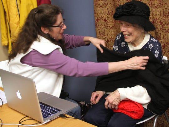 Pinckney Library volunteer Jennifer Brennan, left,
