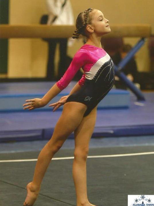 Erika Mills_Level 4 All-Around State Champ.jpg