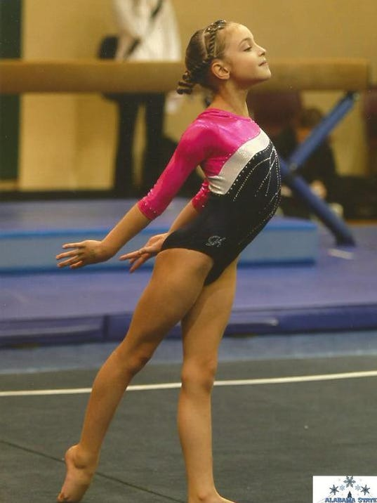 Erika Mills_Level 4 All-Around State Champ.jpg