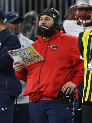 Matt Patricia holds his play sheet on the sideline in the third quarter against the Eagles in Super Bowl LII on Sunday.