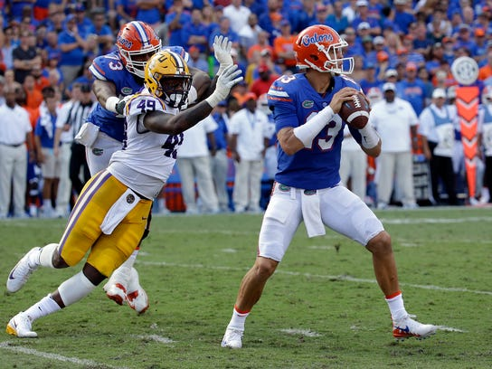 Florida quarterback Feleipe Franks (13) looks for a receiver as LSU linebacker Arden Key (49) puts on pressure during the first half of an NCAA college football game, Saturday, Oct. 7, 2017, in Gainesville, Fla.LSU won 17-16. (AP Photo/John Raoux)