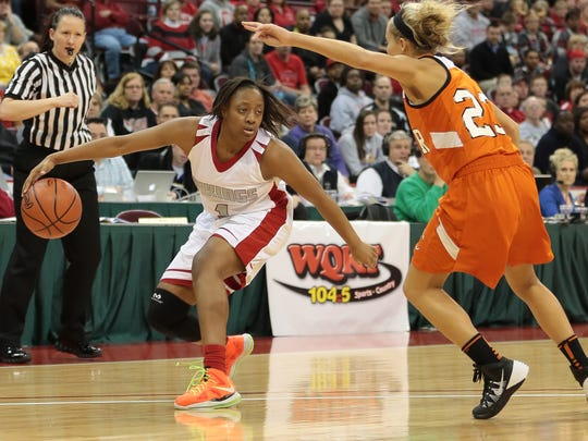 Princeton's Kelsey Mitchell drives to the basket during the Vikings' state championship game against North Canton Hoover, Saturday, March, 15, 2014. (Tony Tribble for the Enquirer)