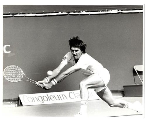 Jimmy Connors returns a serve during the Congoleum