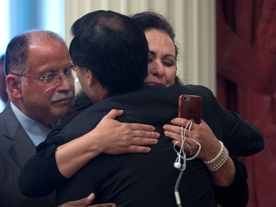 Assemblywoman Lorena Gonzalez, D-San Diego, right, hugs Sen. Richard Pan, D-Sacramento, after he cast the final vote needed to approve her farmworker overtime bill, Monday, Aug. 22. If approved by the Assembly and signed by the governor, Gonzalez's AB1066 would require farmworkers to receive overtime after working eight hours.