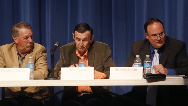 Incumbent city councilors DeLaws Lindsay and Elwin Roark and Mayor Scott Eckstein participate Tuesday in a candidate forum at Bloomfield High School.