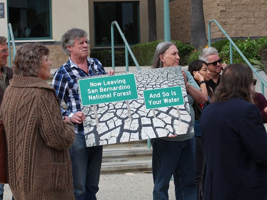 A group of people opposing Nestle's use of water from