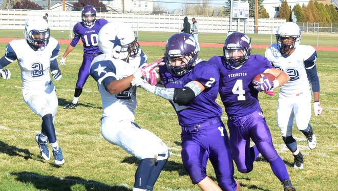 Yerington sophomore Michael Monahan (4) follows the lead block of Jose Rubio (2) as he runs a fly sweep during last Saturday's 42-6 victory over Agassi Prep, sending the Lions to Saturday's NIAA Division III State Football Championship game in Las Vegas.