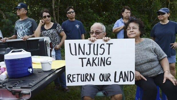 Juan Martinez Flores, son of Benigno Leon Guerrero Flores, protests with family at the gate of the Guam National Wildlife Refuge - Ritidian Unit, in the early 1990s.