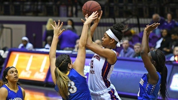 Northwestern State's Victoria Miller attempts a contested jumper during a 60-44 loss to McNeese on Saturday in Prather Coliseum.