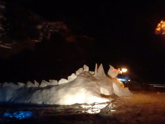 A snow dragon shoots fire into the air at the 7 kilometer