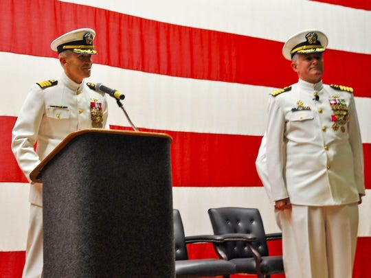 Capt. Philip Brock reads through his official orders appointing him as commanding officer, NASCC, as Capt. Steve Banta turns over the helm of the South Texas installation situated along Corpus Christi Bay during a change of command ceremony, July 20, 2017.