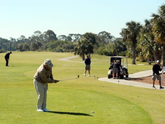 Jim Culver chips a few golf balls near the first tee