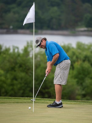 J.C. Guthrie takes a shot during the Cosgrove Golf Tournament at Green Hill Golf Course last month.