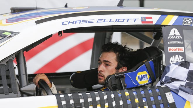 Chase Elliott drives into victory lane after winning at Charlotte Motor Speedway in Concord, N.C., on Sunday.