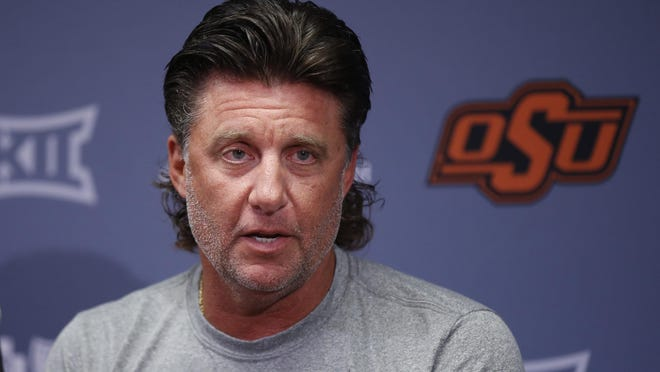 Mike Gundy and the Oklahoma State Cowboys will have to wait one more week before their season gets kicked off. The Cowboys' opener versus Tulsa was postponed due to COVID-19. [Sue Ogrocki/The Associated Press