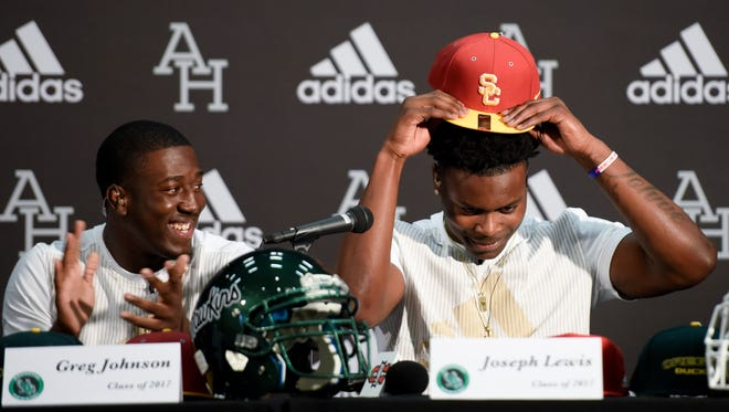 Teammates Greg Johnson, left, and Joseph Lewis from Hawkins High School in Los Angeles announce they're both signing with USC on Wednesday.