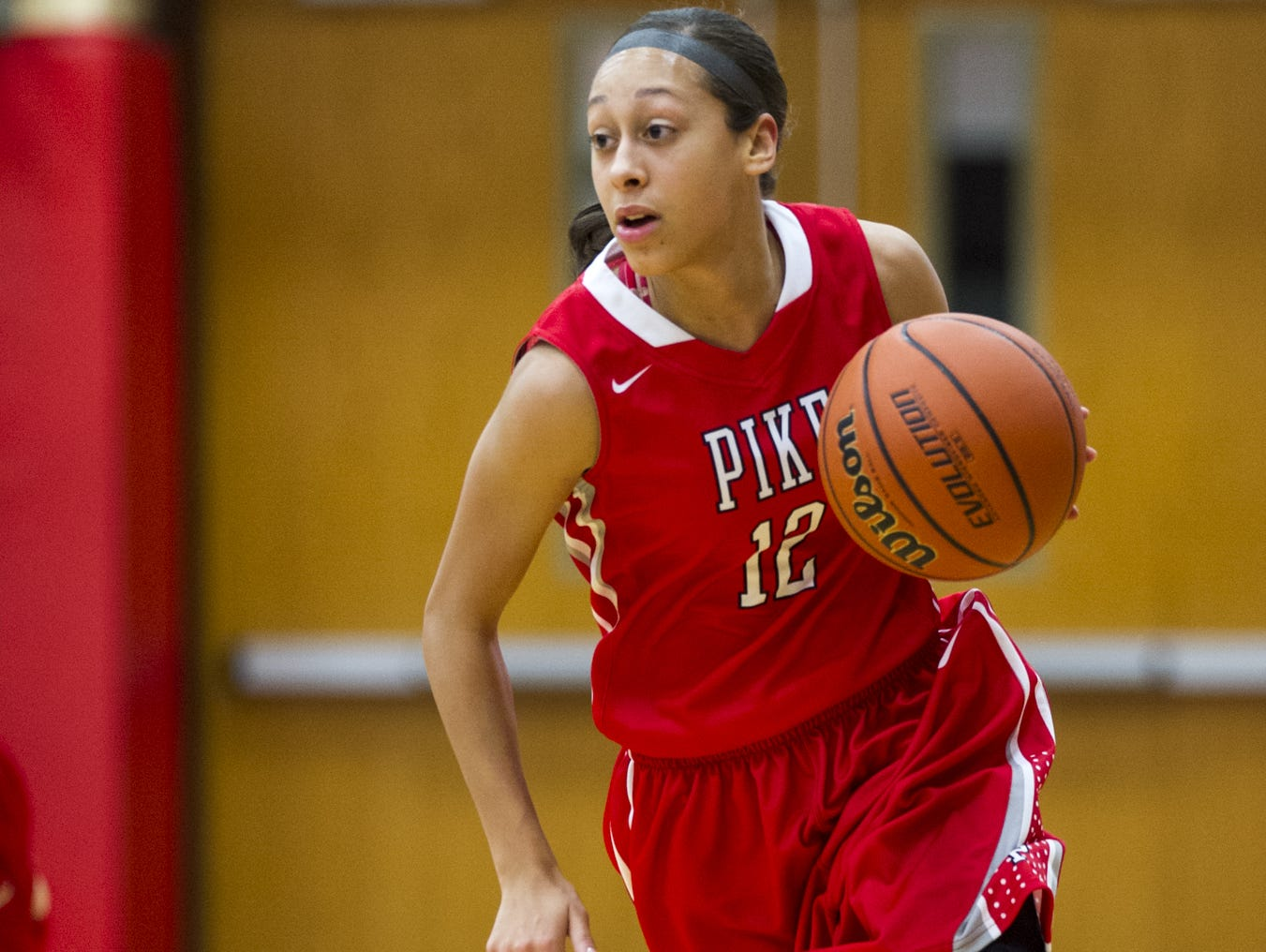 Pike High School senior Alyssa Clay (12) brings the ball up court after a rebound during first half action. Roncalli High School hosted Pike High School in girls' varsity basketball action, Saturday, Nov. 15, 2014.