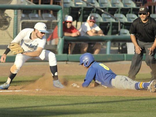 Exeter's Alex Lagrutta, right, slides into third base