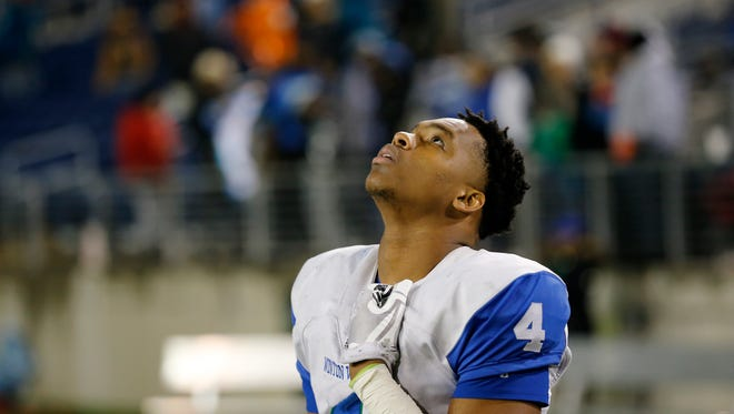 Winton Woods Warriors senior Markief White (4) stands by himself after the fourth quarter of the OHSAA Div. II State Championship game between Archbishop Hoban and Winton Woods at Tom Benson Hall of Fame Stadium in Canton, Ohio, on Thursday, Nov. 30, 2017. Hoban held on to a wide halftime lead to clinch the state title, 42-14, over Winton Woods.