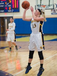 Greencastle's Hannah Crist (13) takes a shot at the