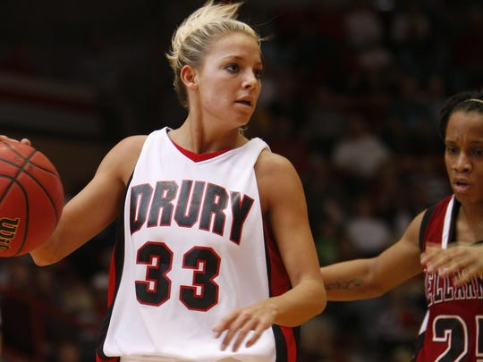 Molly Miller, then Carter, looks for a pass during her days on Drury's basketball team.