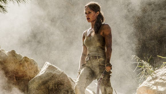 Alicia Vikander carries her ax in 'Tomb Raider.'