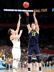 Moritz Wagner shoots over Villanova's Collin Gillespie during the 2018 national championship game April 2 in San Antonio.