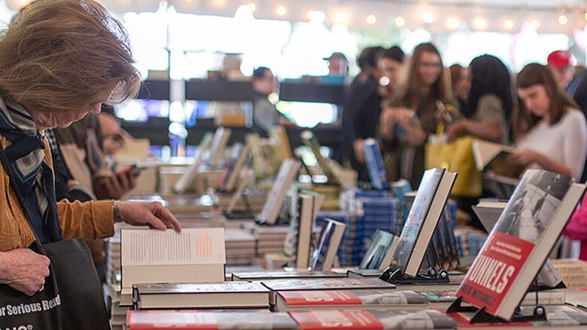 Shoppers browse the book tent during a previous Savannah Book Festival.
