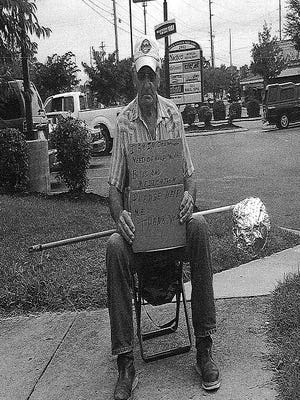 This photos of a panhandler holding a pole device to collect money was included in the Murfreesboro City Council online agenda packet in 2015. A new ordinance passed Thursday, Nov. 17, makes it illegal for panhandlers to take donations from vehicles on public streets.