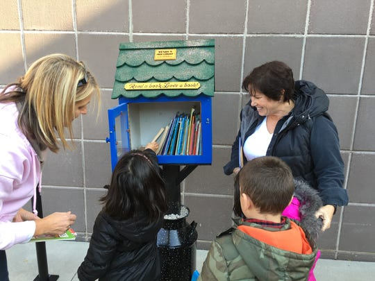 A donor recently brought a Little Library to Longfellow Elementary School. Julie Koleno and her kindergarten students filled the Little Library with books to share.
