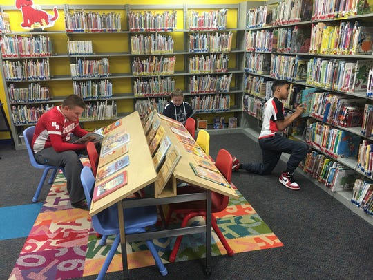 Youngsters enjoy the newly restored children's room at the Rose Memorial Library.
