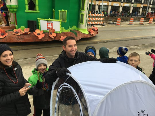 Jon Adams, 42, of Birmingham shows off an Under-the-Weather bubble he used to keep his family warm during America's Thanksgiving Parade on Nov. 26, 2015.