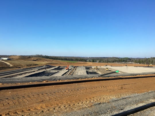 Construction crews work in 2015 at the Gallatin Fossil Plant on the first cell of a 52.4-acre lined landfill for dry coal ash storage.