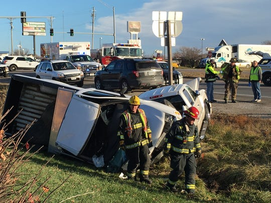 A truck vaulted off Interstate 80, rolled down a ditch and crashed into another truck on Northeast 14th Street at about 9 a.m. Thursday.